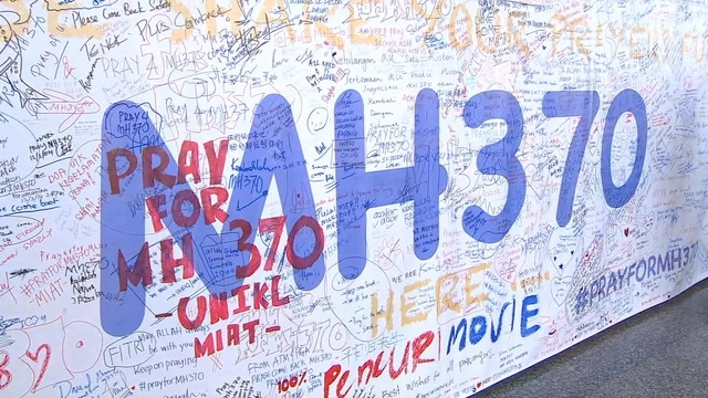 CNN takes a look at the large wall inside the Kuala Lumpur airport, where hundreds leave written messages of hope for those aboard the missing Malaysian Airlines Flight 370.