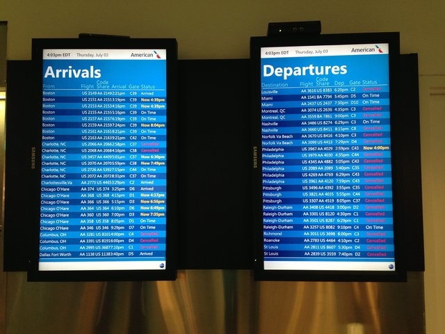 The arrivals and departures board at New York show delayed and canceled flights as thunderstorms moved through the area on July 3, 2014. (CNN)