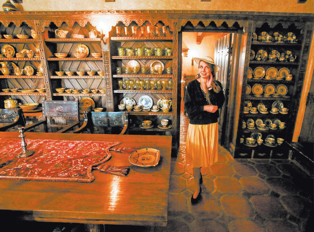A National Park Service tour guide dressed in period clothes stands in the dining room at ScottyÕs Castle in Death Valley National Park on Saturday March 9, 2013.  (Jeff Scheid/Las Vegas Review-J ...