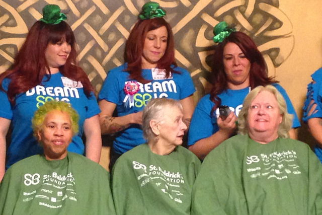 Sheila Whitmore joins with St. Baldrick's teammates Margie Maura and Joani Emery Saturday at McMullan's Irish Pub.