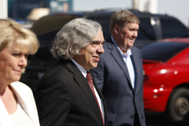 U.S. Department of Energy Secretary Ernest Moniz tours a solar panel installment project on the roof of Mandalay Bay Convention Center in Las Vegas Wednesday, Oct. 22, 2014. The solar panels are s ...