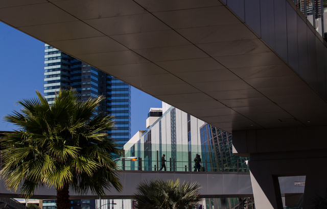 People walk and take in the sights along a pedestrian bridge over Harmon Avenue at Las Vegas Boulevard in Las Vegas on Wednesday, March 4, 2015.  (Chase Stevens/Las Vegas Review-Journal)