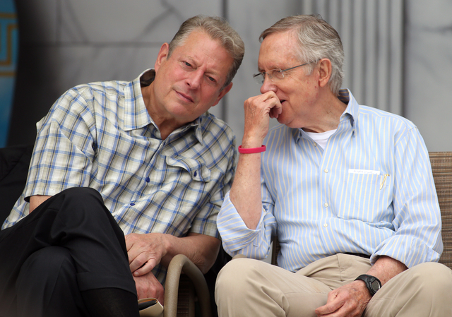 Former Vice President Al Gore and Senate Majority Leader Harry Reid talk at the 17th annual Lake Tahoe Summit conference at Sand Harbor, near Incline Village, Nev., on Monday, Aug. 19, 2013.  (Cat ...