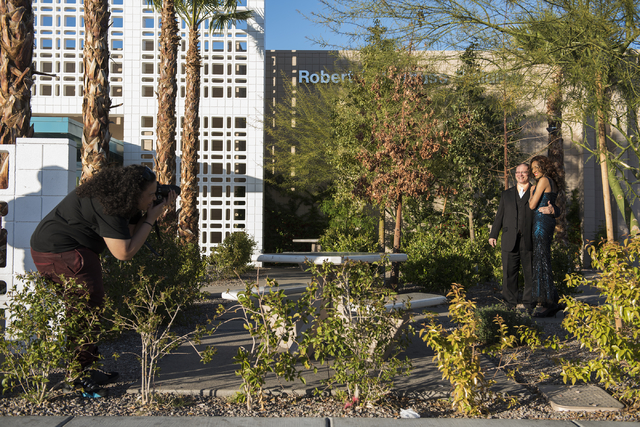 Wedding photographer Ashley Level, left, photographs Jazmynne Young and her fiance, Mark Matthews, during prewedding photos at The Gay and Lesbian Center in Las Vegas on Saturday, Mar. 7, 2015. Th ...