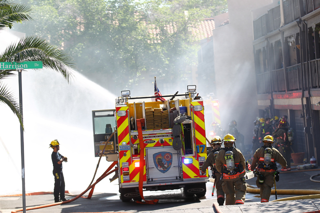 Clark County firefighters work on extinguishing an apartment fire off of Tropicana Avenue near McLeod Drive in Las Vegas on March 30, 2015. (Chase Stevens/Las Vegas Review-Journal) Follow Chase St ...
