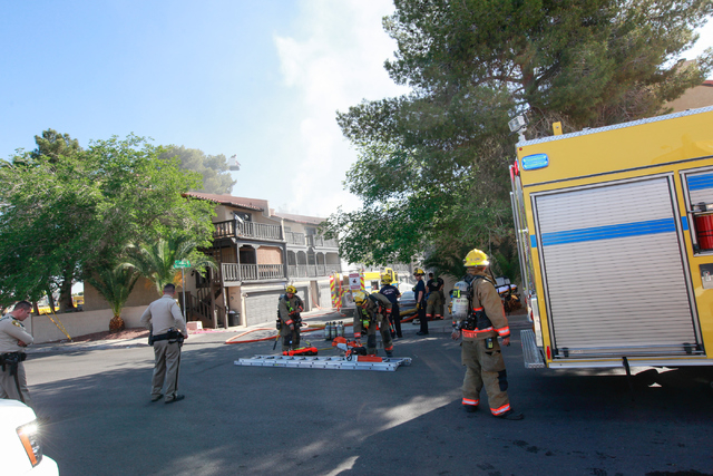 Clark County firefighters respond to an apartment fire off of Tropicana Avenue near McLeod Drive in Las Vegas on March 30, 2015. (Chase Stevens/Las Vegas Review-Journal) Follow Chase Stevens on Tw ...