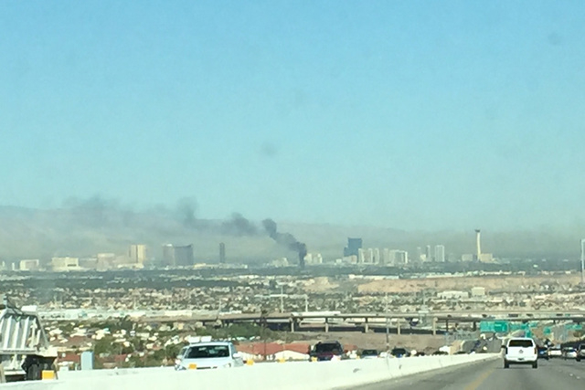 Westbound Tropicana Avenue near McLeod Drive is closed because of a building fire Monday morning, police say. (Chase Stevens/Las Vegas Review-Journal)
