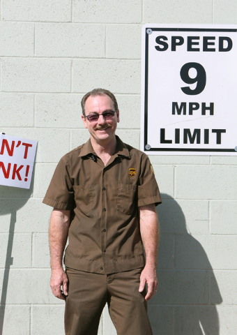 United Parcel Service driver Rod Little stands near safety signs posted at the UPS Customer Center located at 740 N. Martin L. King Blvd. Monday, March 23, 2015, in Las Vegas. Little is a recipien ...