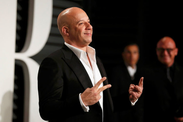 """Actor Vin Diesel arrives at the 2015 Vanity Fair Oscar Party in Beverly Hills, California, Feb. 22, 2015. Diesel stars in  """"Furious 7,"""" which open April 3. Universal Studios Hollywood plans to ope ..."""