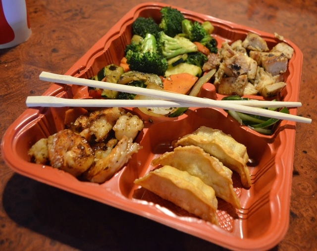 At Volcano Grille, 7150 S. Durango Drive, No. 110, bento boxes include a choice of two proteins and two sides. Grilled vegetables and a cucumber salad also are included. (Ginger Meurer/View) (Clic ...