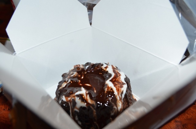 Molten Chocolate Lava Cake at Volcano Grille is wrapped up to go in two boxes: one for the warm gooey cake and one for the ice cream. (Ginger Meurer/View)