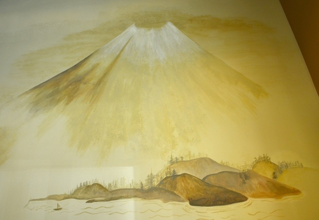 A volcano mural decorates the wall of Volcano Grille. (Shannon Mikkelsen/Special to View)