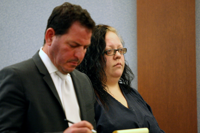 Standing before Judge Janiece Marshall with her lawyer, Todd Leventhal, Jesse Vonstaden, the owner of four dogs that mauled a 65-year-old Las Vegas woman and her neighbor, agrees to plead guilty o ...