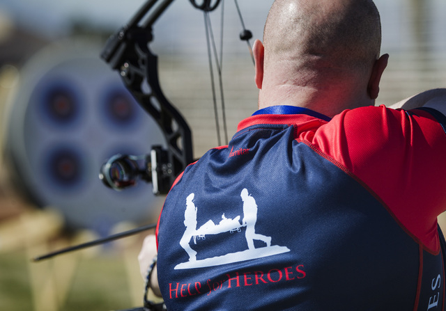 Alastair Pingram, a member of the Great Britain Team, competes in archery during the Olympics for Wounded Warriors  Friday, Feb 27, 2015, at Nellis Air Force Base. Wounded Warriors teams from Aust ...