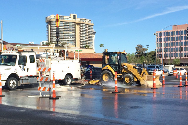 Workers from Las Vegas Valley Water District are seen at the water main break at Desert Inn Road and Maryland Parkway on Thursday, March 26, 2015. Crews are trying to replace a leaking valve but h ...