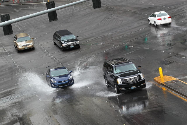 A water main break on the Las Vegas Strip, between Harmon and Tropicana avenues, has shut down two northbound lanes of traffic Wednesday morning, March 11, 2015. (Chase Stevens/Las Vegas Review-Jo ...