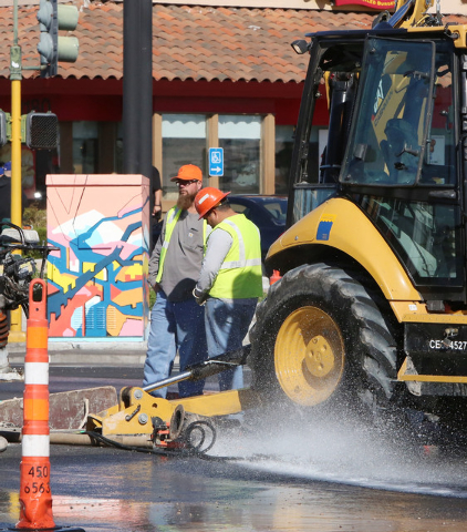 Workers from Las Vegas Valley Water District are seen at the water main break at the intersection of Desert Inn Road and Maryland Parkway on Thursday, March 26, 2015. Crews are trying to replace a ...