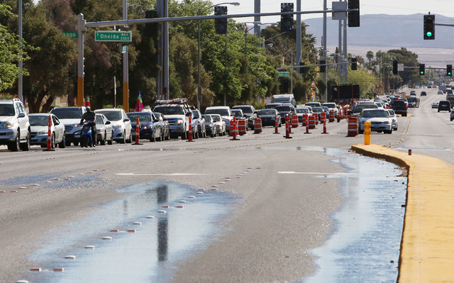 Traffic is backed up on Desert Inn Road as crews replace a leaking water valve at Desert Inn and Maryland Parkway on Thursday, March 26, 2015. Crews are trying to replace a leaking valve but have  ...