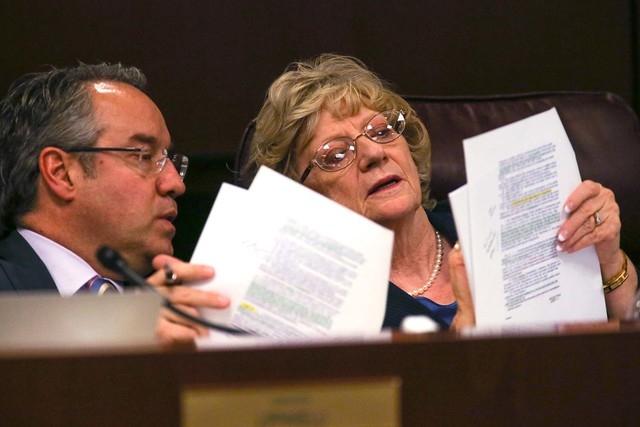 Nevada Sens. Mark Lipparelli, R-Las Vegas, and Joyce Woodhouse, D-Henderson, talk in the Senate Education committee hearing at the Legislative Building in Carson City, Nev., on Thursday, March 26, ...