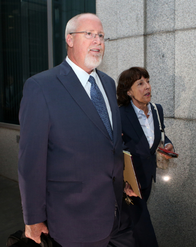 Harvey Whittemore and his wife Annette leave the Federal Courthouse in Reno, Nev., on Monday, Sept. 30, 2013. Whittemore was sentenced Monday to 24 months in prison on charges related to unlawfull ...