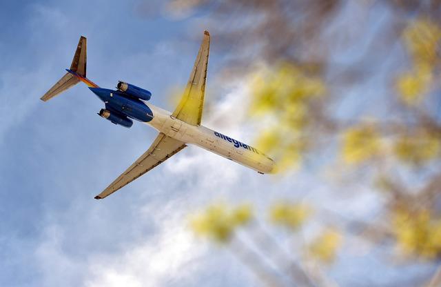 An Allegiant Airline jet flies over on March 16, 2015, in Las Vegas. (David Becker/Las Vegas Review-Journal)