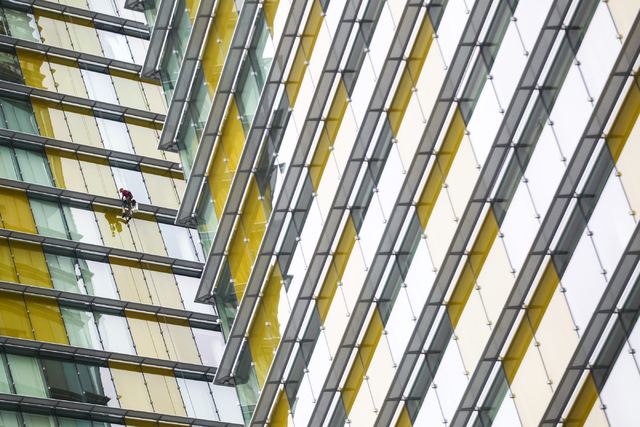 A window washer works on one of the 37-story Veer towers at CityCenter in Las Vegas on Wednesday, March 11, 2015. (Chase Stevens/Las Vegas Review-Journal)
