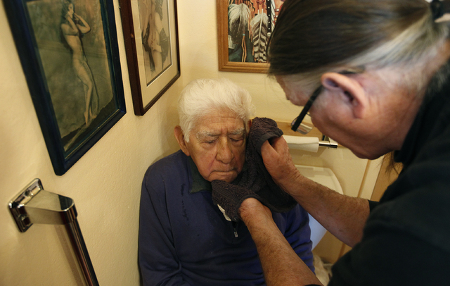 Guadalupe Olvera gets a shave from his son-in-law Bob Shultz at their home in Aptos, Calif., March 27, 2014. (John Locher/Las Vegas Review-Journal file)