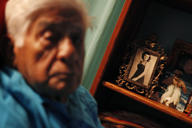 Guadalupe Olvera keeps a picture of his wife, Carmela, on a shelf in his room at his home in Aptos, Calif., March 27, 2014. (John Locher/Las Vegas Review-Journal file)