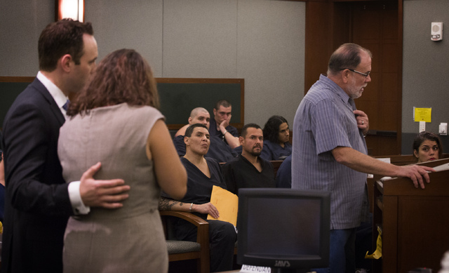 Dr. Ron Dutton, right, makes a victim impact statement during the sentencing of Patience Bristol, center, while her attorney, Warren Geller, comforts her at the Regional Justice Center on Wednesda ...