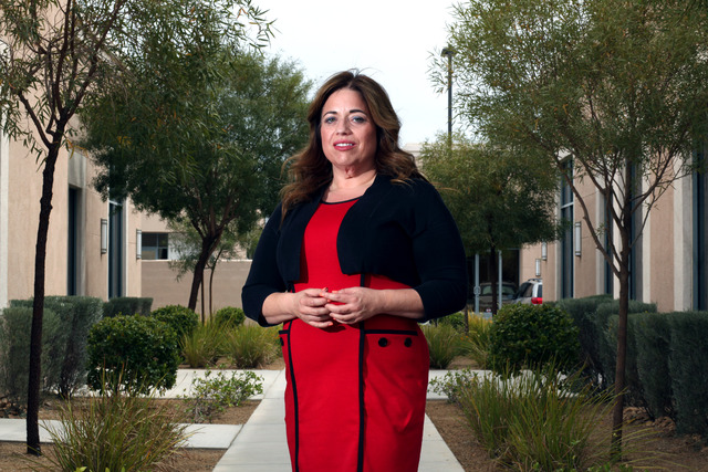 Kristina Berger poses for a portrait outside her lawyer's office in Las Vegas on Wednesday, May 28, 2014. Berger had inherited an estimated $400,000 estate from her mother. Struggling with a bipol ...