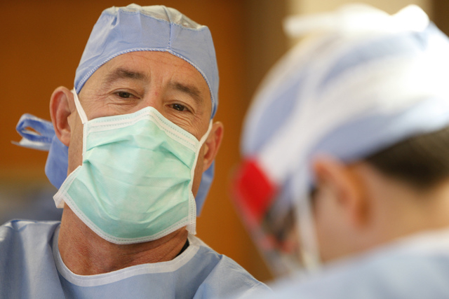 Orthopedic surgeon Dr. Michael Crovetti looks up while performing a hip replacement surgery procedure at the Coronado Surgery Center in Henderson, Monday, April 20, 2015. The surgery was Crovetti' ...