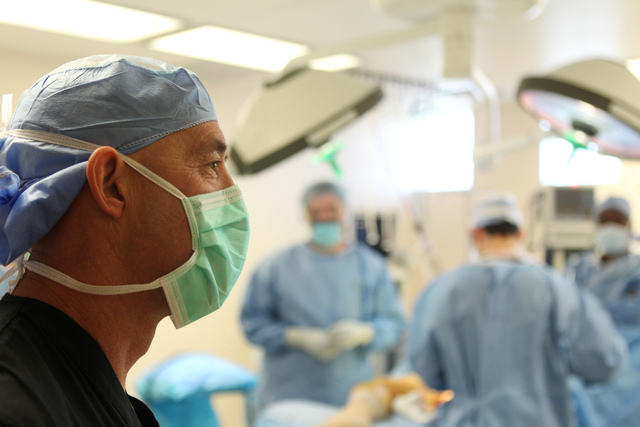 Orthopedic surgeon Dr. Michael Crovetti looks on after completing a hip replacement surgery procedure at the Coronado Surgery Center in Henderson, Monday, April 20, 2015. The surgery was Crovetti' ...