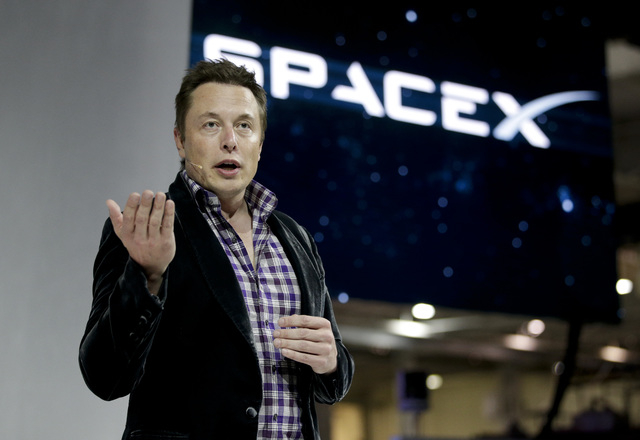Elon Musk, CEO and CTO of SpaceX, introduces the SpaceX Dragon V2 spaceship at the SpaceX headquarters on, in Hawthorne, Calif.  Tesla Motors is opening access to its patents to accelerate electri ...