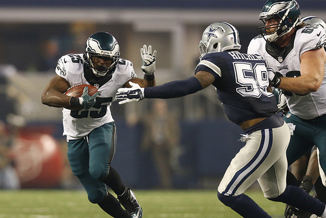 Nov 27, 2014; Arlington, TX, USA; Philadelphia Eagles running back LeSean McCoy (25) runs with the ball for a third quarter touchdown against the Dallas Cowboys linebacker Anthony Hitchens (59) at ...