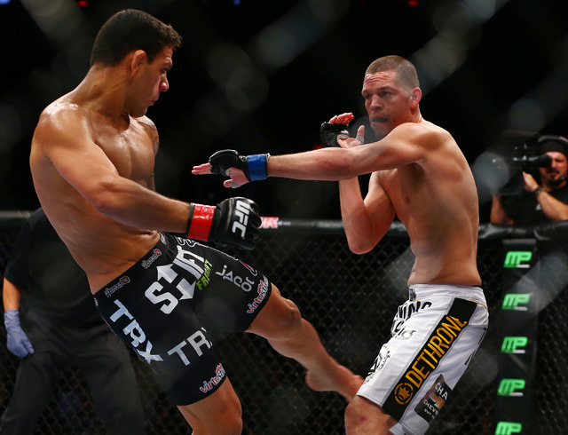 Nate Diaz, right, defends against Rafael dos Anjos during UFC Fight Night at US Airways Center in Phoenix on Dec. 13, 2014. (Mark J. Rebilas-USA TODAY Sports)