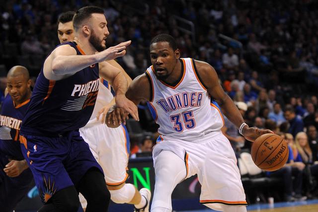 Dec 14, 2014; Oklahoma City, OK, USA;  Oklahoma City Thunder forward Kevin Durant (35) handles the ball against Phoenix Suns center Miles Plumlee (22) during the third quarter at Chesapeake Energy ...