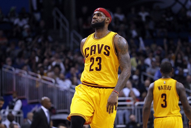 Dec 26, 2014; Orlando, FL, USA; Cleveland Cavaliers forward LeBron James (23) reacts after he made a shot against the Orlando Magic during the second half at Amway Center. Cleveland Cavaliers defe ...