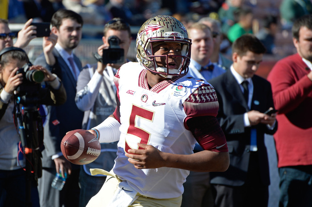 Jan 1, 2015; Pasadena, CA, USA; Florida State Seminoles quarterback Jameis Winston (5) warms up prior to the 2015 Rose Bowl college football game at Rose Bowl. (Robert Hanashiro-USA TODAY Sports)