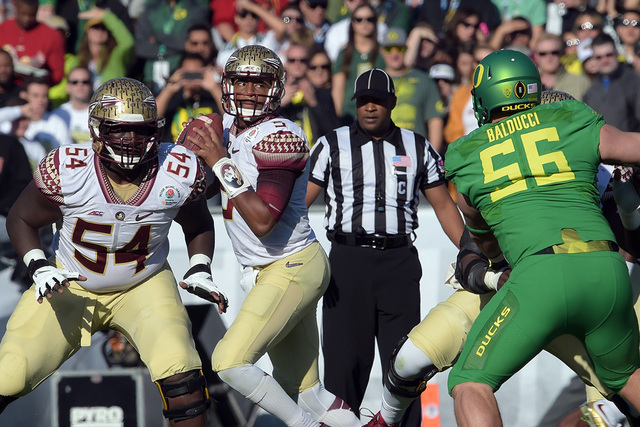 Jan 1, 2015; Pasadena, CA, USA; Florida State Seminoles quarterback Jameis Winston (5) drops back to pass against the Oregon Ducks in the 2015 Rose Bowl college football game at Rose Bowl. (Kelvin ...