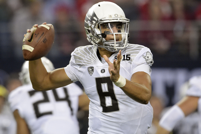 Jan 12, 2015; Arlington, TX, USA; Oregon Ducks quarterback Marcus Mariota (8) looks to pass during the first quarter against the Ohio State Buckeyes in the 2015 CFP National Championship Game. (Ki ...