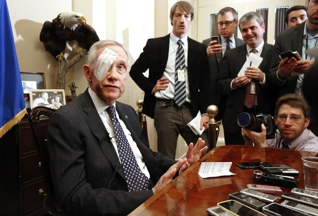 U.S. Senate Minority Leader Harry Reid, D-Nev., holds a news conference in his office at the U.S. Capitol in Washington, Thursday, Jan. 22, 2015. Reid injured his right eye and bones in his face d ...