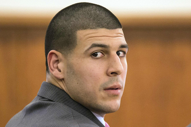 Former New England Patriots player Aaron Hernandez glanced towards the media during his murder trial at Bristol County Superior Court in Fall River, Massachusetts February 3, 2015. The courthouse  ...