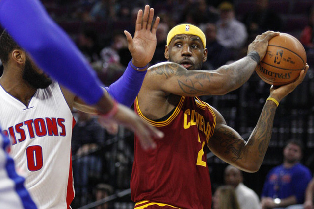 Feb 24, 2015; Auburn Hills, MI, USA; Cleveland Cavaliers forward LeBron James (23) looks for an open man against Detroit Pistons center Andre Drummond (0) during the second quarter at The Palace o ...