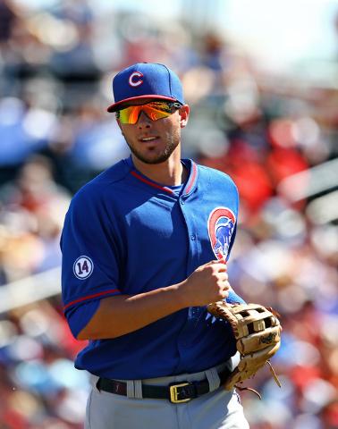 Mar 10, 2015; Goodyear, AZ, USA; Chicago Cubs third baseman Kris Bryant against the Cleveland Indians during a spring training baseball game at Goodyear Ballpark. (Mark J. Rebilas-USA TODAY Sports)