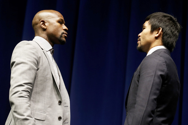 """Eleven-time, five-division world boxing champion Floyd """"Money"""" Mayweather (L) and eight-division world champion Manny """"Pac-Man"""" Pacquiao attend a press conference  in Los Angeles, California March ..."""