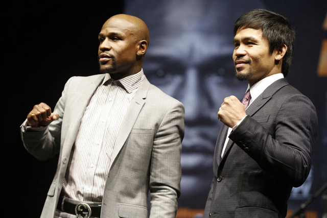 "Floyd ""Money"" Mayweather (L) and eight-division world champion Manny ""Pac-Man"" Pacquiao on March 11, 2015. (REUTERS/Lucy Nicholson)"