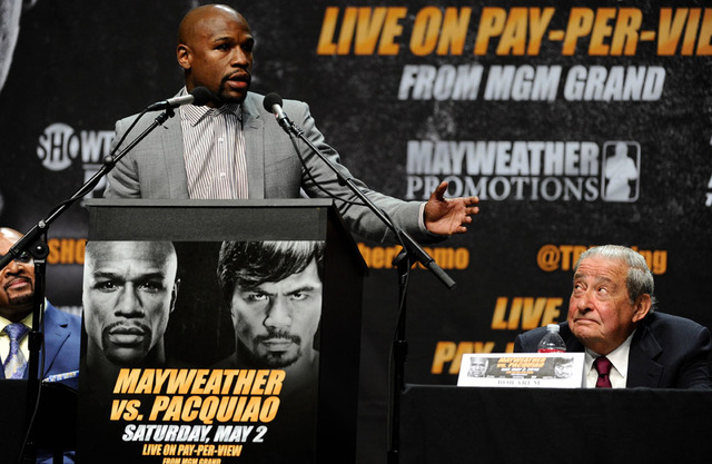 Mar 11, 2015; Los Angeles, CA, USA; Floyd Mayweather talks during a news conference to announce his fight  with Many Pacquiao on May 2, 2015. Right is Pacquiao promoter Bob Arum. Mandatory Credit: ...