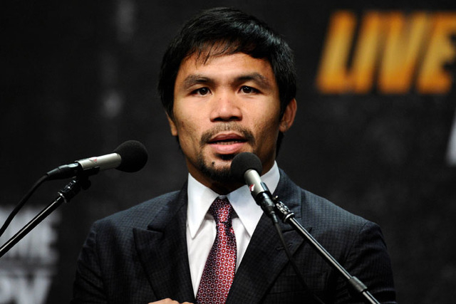 Mar 11, 2015; Los Angeles, CA, USA; Manny Pacquiao during a press conference to announce his fight with Floyd Mayweather fight on May 2, 2015 at Los Angeles. (Robert Hanashiro-USA TODAY Sports)