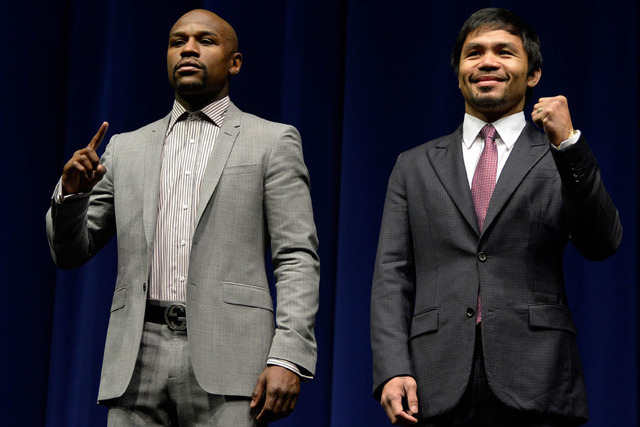 Mar 11, 2015; Los Angeles, CA, USA; Floyd Mayweather and Manny Pacquiao pose for photographers during a press conference to announce their fight on May 2, 2015 at Los Angeles. (Robert Hanashiro-US ...
