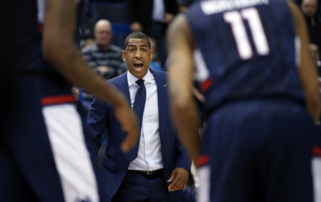 Mar 13, 2015; Hartford, CT, USA; Connecticut Huskies head coach Kevin Ollie watches from the sideline as they take on the Cincinnati Bearcats in the first half during the quarterfinal round of the ...